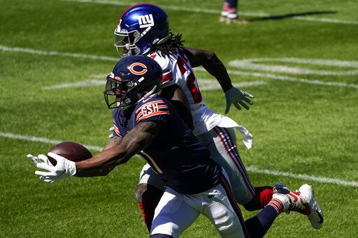 Chicago Bears wide receiver Anthony Miller (17) tries to catch a pass as New York Giants cornerback Isaac Yiadom (27) defends during the first half of an NFL football game in Chicago, Sunday, Sept. 20, 2020.