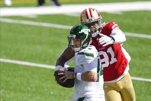 San Francisco 49ers defensive end Arik Armstead (91) sacks New York Jets quarterback Sam Darnold (14) during the first half of an NFL football game Sunday, Sept. 20, 2020, in East Rutherford, N.J.