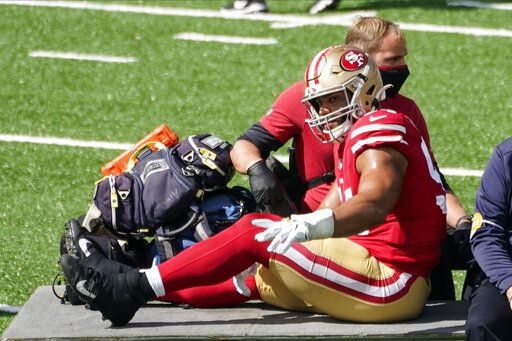 San Francisco 49ers' Solomon Thomas (94) is carted off the field during the first half of an NFL football game against the New York Jets, Sunday, Sept. 20, 2020, in East Rutherford, N.J.