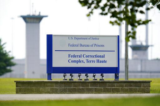 FILE - In this Aug. 28, 2020, file photo shows the federal prison complex in Terre Haute, Ind. A wave of federal executions by the Trump administration after a 17-year hiatus are set to resume. If it goes ahead as scheduled Tuesday, Sept. 22, 2020, William Emmett LeCroy would be the sixth federal death-row inmate executed this year at the U.S. prison in Terre Haute, Indiana. Another is scheduled Thursday.