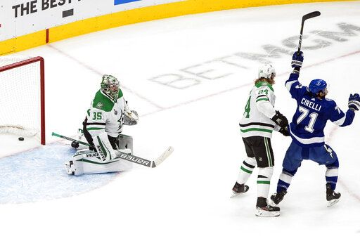 Dallas Stars goalie Anton Khudobin (35) is scored against as Tampa Bay Lightning's Anthony Cirelli (71) reacts and Stars' Roope Hintz (24) defends during first-period NHL Stanley Cup finals hockey action in Edmonton, Alberta, Monday, Sept. 21, 2020. (Jason Franson/The Canadian Press via AP)