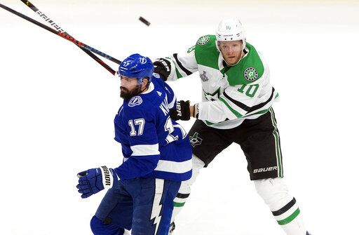 Dallas Stars' Corey Perry (10) and Tampa Bay Lightning's Alex Killorn (17) battle for the puck during first-period NHL Stanley Cup finals hockey action in Edmonton, Alberta, Monday, Sept. 21, 2020. (Jason Franson/The Canadian Press via AP)