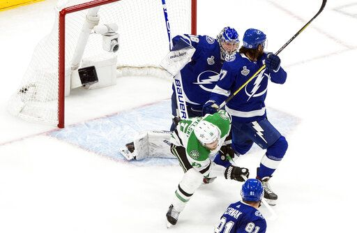Dallas Stars' Joe Pavelski (16) scores against Tampa Bay Lightning goalie Andrei Vasilevskiy (88) as Lightning defenseman Ryan McDonagh (27) defends during second-period NHL Stanley Cup finals hockey action in Edmonton, Alberta, Monday, Sept. 21, 2020. (Jason Franson/The Canadian Press via AP)