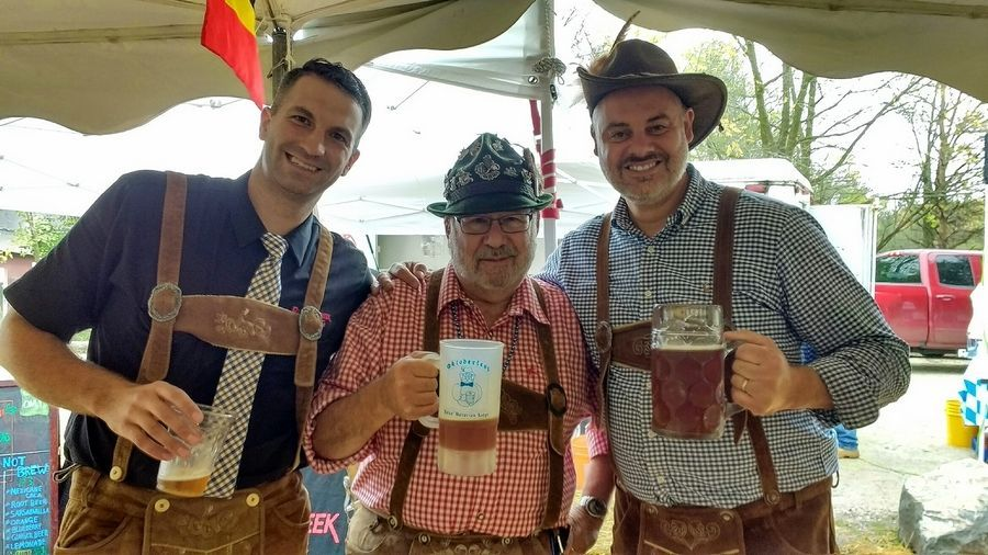 Buffalo Creek Brewing co-owners Josh Czarnik, left, and Mike Marr, right, pose with Alex Bersin during the brewpub's 2019 Oktoberfest celebration.Buffalo Creek Brewing