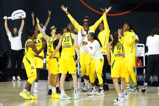 The Seattle Storm celebrate their win over Minnesota Lynx during the second half of Game 1 of a WNBA basketball semifinal round playoff series Tuesday, Sept. 22, 2020, in Bradenton, Fla.