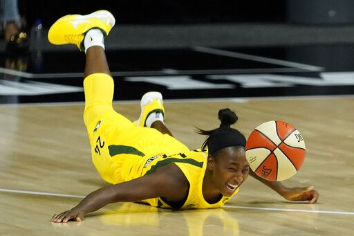 Seattle Storm guard Jewell Loyd (24) dives for a loose ball during the second half of Game 1 of a WNBA basketball semifinal round playoff series against the Minnesota Lynx Tuesday, Sept. 22, 2020, in Bradenton, Fla.