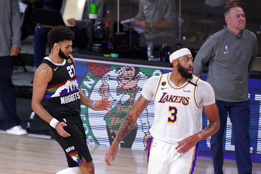 Denver Nuggets' Jamal Murray (27) celebrates sinking a 3-point basket as Los Angeles Lakers' Anthony Davis (3) and head coach Michael Malone, right rear, look on during the second half of Game 3 of the NBA basketball Western Conference final Tuesday, Sept. 22, 2020, in Lake Buena Vista, Fla.