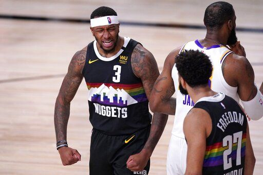 Denver Nuggets' Torrey Craig (3) and Jamal Murray (27) celebrate a dunk by Murray as Los Angeles Lakers' LeBron James, right walks past during the second half of Game 3 of the NBA basketball Western Conference final, Tuesday, Sept. 22, 2020, in Lake Buena Vista, Fla.