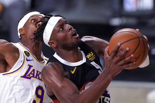 Denver Nuggets forward Jerami Grant (9) goes up for a shot in front of Los Angeles Lakers' Rajon Rondo, left, during the second half of Game 3 of the NBA basketball Western Conference final Tuesday, Sept. 22, 2020, in Lake Buena Vista, Fla.