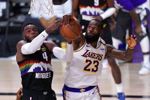 Denver Nuggets forward Paul Millsap (4) has his shot blocked by Los Angeles Lakers' LeBron James (23) during the second half of Game 3 of the NBA basketball Western Conference final Tuesday, Sept. 22, 2020, in Lake Buena Vista, Fla.