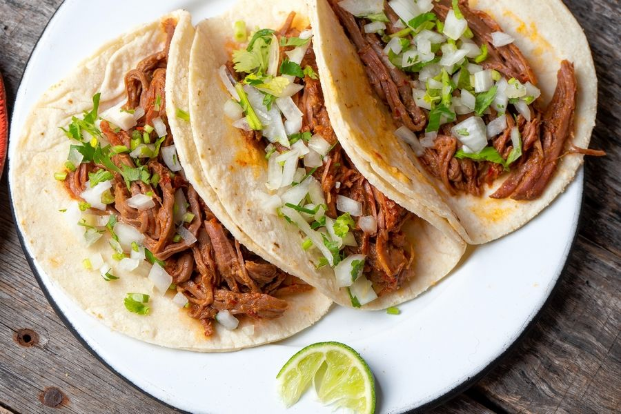Traditional Mexican beef barbacoa tacos.