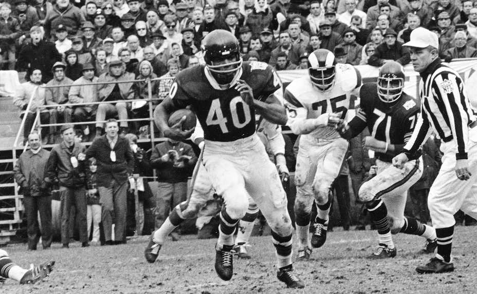 Bears Hall of Famer Gale Sayers, here playing in October 1969, died Wednesday at 77. He is considered among the best open-field runners the game has ever seen.