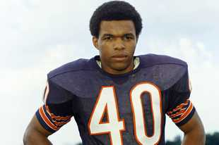 Bears running back Gale Sayers, here in 1970, died Wednesday at 77.