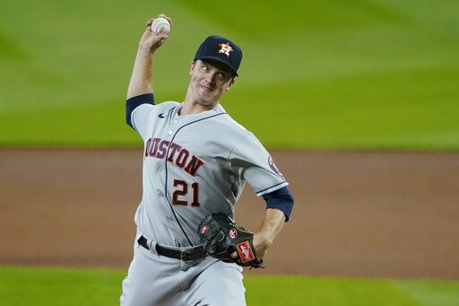 Houston Astros starting pitcher Zack Greinke throws against the Seattle Mariners during the first inning of a baseball game, Wednesday, Sept. 23, 2020, in Seattle.