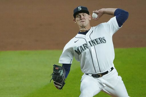 Seattle Mariners starting pitcher Nick Margevicius throws against the Houston Astros during the first inning of a baseball game, Wednesday, Sept. 23, 2020, in Seattle.