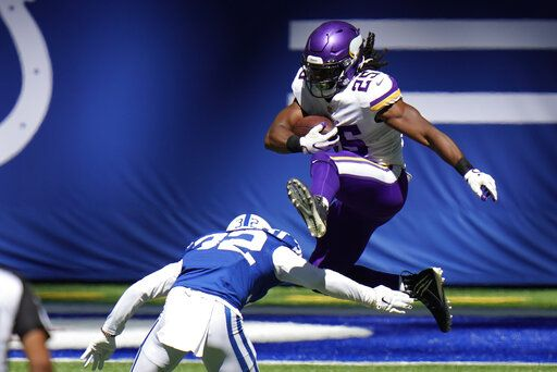 Minnesota Vikings' Alexander Mattison (25) leaps over Indianapolis Colts' Julian Blackmon (32) during the first half of an NFL football game, Sunday, Sept. 20, 2020, in Indianapolis.