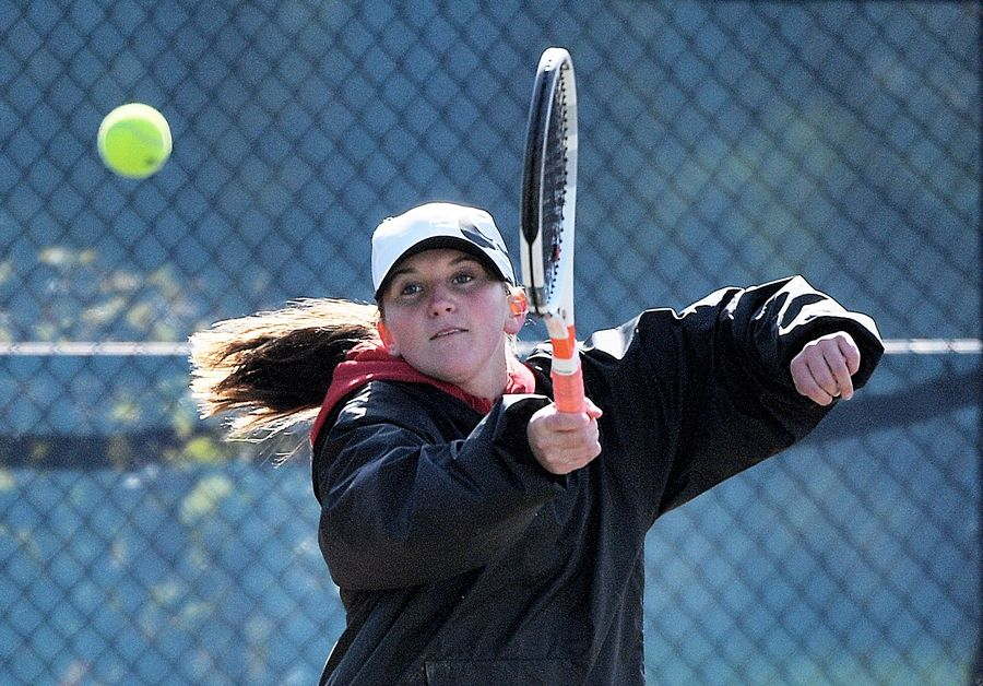 Batavia's Leah Puttin returns a shot at the Dukane Conference girls tennis tournament last year. Puttin and Batavia have had a successful start to the 2020 season.