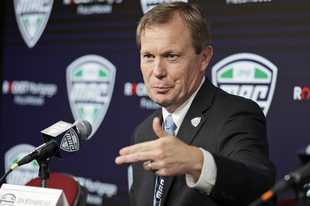 In this March 12, 2020, file photo, Mid-American Conference commissioner Jon Steinbrecher speaks during an NCAA college football news conference in Cleveland. The Mid-American Conference announced Friday, Sept. 25, 2020, that it will have a 6-game football season, meaning all 10 major conferences will play this fall. (AP Photo/Tony Dejak, File)