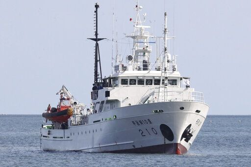 A South Korea's government ship for a fishery guidance, is seen near Yeonpyeong island, South Korea, Thursday, Sept. 24, 2020. According to Seoul, a man disappeared from the government ship that was checking on potential unauthorized fishing in an area south of the boundary on Monday, a day before he was found in North Korean waters. (Choi Jin-suk/Newsis via AP)