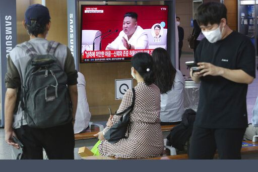 "People watch a screen showing a file image of North Korean leader Kim Jong Un during a news program at the Seoul Railway Station in Seoul, South Korea, Friday, Sept. 25, 2020. Kim apologized Friday over the killing of a South Korea official near the rivals' disputed sea boundary, saying he's ""very sorry"" about the ""unexpected"" and ""unfortunate"" incident, South Korean officials said Friday. The Korean letters read: ""Sorry for South Korea."""