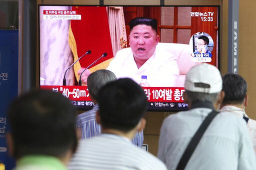 "People watch a screen showing a file image of North Korean leader Kim Jong Un during a news program at the Seoul Railway Station in Seoul, South Korea, Friday, Sept. 25, 2020. Kim apologized Friday over the killing of a South Korea official near the rivals' disputed sea boundary, saying he's ""very sorry"" about the ""unexpected"" and ""unfortunate"" incident, South Korean officials said Friday."