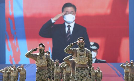 South Korean Special Warfare Command soldiers salute to President Moon Jae-in during a ceremony to mark the 72th Armed Forces Day at the Army's Special Warfare Command in Icheon, South Korea, Friday, Sept. 25, 2020. South Korea says North Korean leader Kim Jong Un has apologized over the killing of a South Korea official. (Lee Jin-wook/Yonhap via AP)
