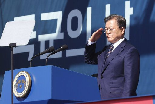 South Korean President Moon Jae-in salutes during a ceremony to mark the 72th Armed Forces Day at the Army's Special Warfare Command in Icheon, South Korea, Friday, Sept. 25, 2020. South Korea says North Korean leader Kim Jong Un has apologized over the killing of a South Korea official. (Lee Jin-wook/Yonhap via AP)
