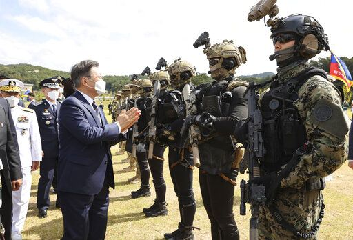 South Korean President Moon Jae-in, left, greets Special Warfare Command soldiers during a ceremony to mark the 72th Armed Forces Day at the Army's Special Warfare Command in Icheon, South Korea, Friday, Sept. 25, 2020. South Korea says North Korean leader Kim Jong Un has apologized over the killing of a South Korea official. (Lee Jin-wook/Yonhap via AP)