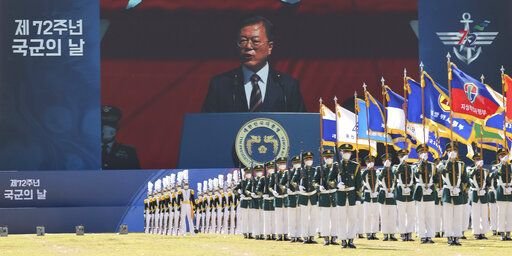 A screen shows South Korean President Moon Jae-in as he speaks during a ceremony to mark the 72th Armed Forces Day at the Army's Special Warfare Command in Icheon, South Korea, Friday, Sept. 25, 2020. South Korea says North Korean leader Kim Jong Un has apologized over the killing of a South Korea official. (Lee Jin-wook/Yonhap via AP)