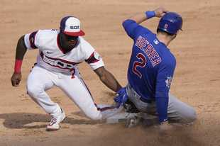 Chicago White Sox shortstop Tim Anderson, left, tags out Chicago Cubs' Nico Hoerner at second during the sixth inning of a baseball game in Chicago, Sunday, Sept. 27, 2020. Nico Hoerner was caught stealing second base.