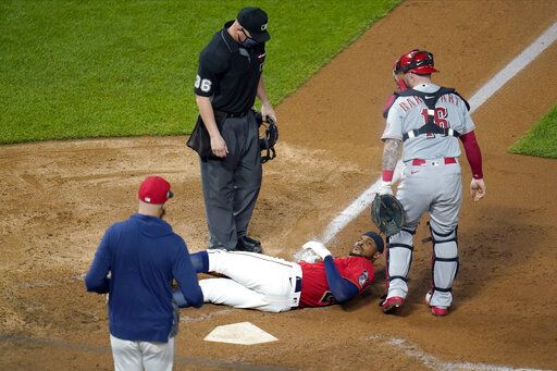 Minnesota Twins' Byron Buxton lies on the ground after being hit by a pitch from Cincinnati Reds' Lucas Sims during the eighth inning of a baseball game Friday, Sept. 25, 2020, in Minneapolis.