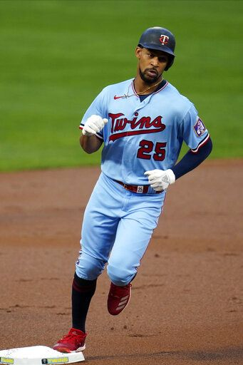 Minnesota Twins' Byron Buxton rounds third base on a solo home run off Detroit Tigers pitcher Tarik Skubal in the first inning of a baseball game Tuesday, Sept. 22, 2020, in Minneapolis.