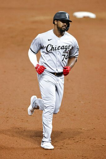 Chicago White Sox's Eloy Jimenez rounds the bases after hitting a two-run home run off Cleveland Indians pitcher Aaron Civale during the fifth inning of a baseball game, Monday, Sept. 21, 2020, in Cleveland.