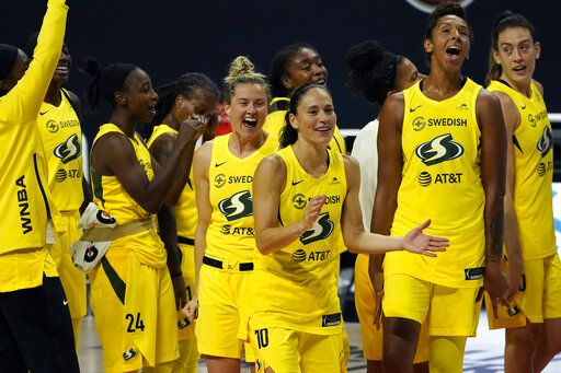The Seattle Storm celebrate after the team defeated the Minnesota Lynx during Game 3 of a WNBA basketball semifinal round playoff series Sunday, Sept. 27, 2020, in Bradenton, Fla. The Storm move onto the WNBA finals.