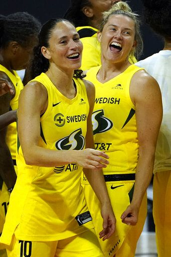 Seattle Storm guard Sue Bird (10) and guard Sami Whitcomb celebrate after the team defeated the Minnesota Lynx during Game 3 of a WNBA basketball semifinal round playoff series Sunday, Sept. 27, 2020, in Bradenton, Fla. The Storm advance to the WNBA finals.