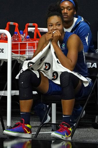 Minnesota Lynx forward Napheesa Collier sits on the bench late in the team's loss to the Seattle Storm during Game 3 of a WNBA basketball semifinal round playoff series Sunday, Sept. 27, 2020, in Bradenton, Fla. The Lynx were eliminated.