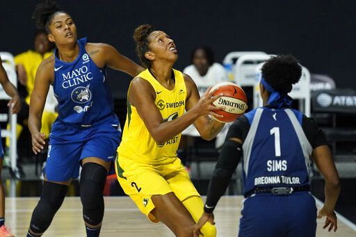 Seattle Storm center Mercedes Russell (2) goes up for a shot between Minnesota Lynx forward Damiris Dantas (12) and guard Odyssey Sims (1) during the second half of Game 3 of a WNBA basketball semifinal round playoff series Sunday, Sept. 27, 2020, in Bradenton, Fla.