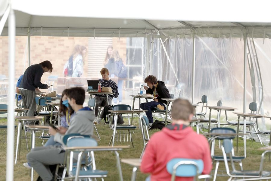 Students eat lunch outside at Carmel Catholic High School in Mundelein.