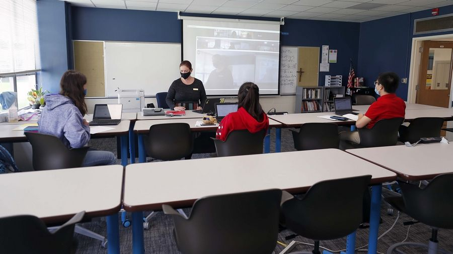 Erin Major teaches Calculus III at Carmel Catholic High School in Mundelein. Major uses special video technology that follows her as she walks around the classroom so that her remote students can see her at all times as well.