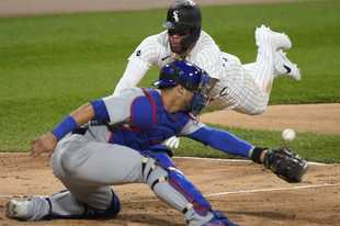 The White Sox's Yoan Moncada scores on a double by Jose Abreu as Cubs catcher Willson Contreras misses the throw during Saturday's Sox win at Guaranteed Rate Field. For the first time since 2008 the Sox and Cubs are both in the playoffs. The Sox are in Oakland Tuesday and the Cubs open at home Wednesday against Miami.