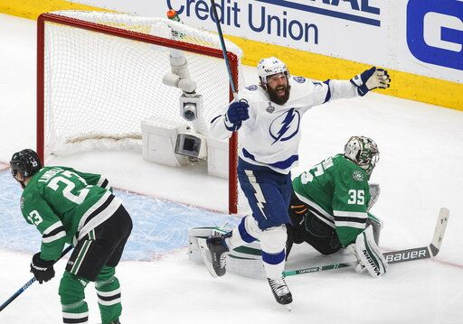 Tampa Bay Lightning's Pat Maroon (14) reacts as the puck goes in past Dallas Stars' goalie Anton Khudobin (35) on a shot from Lightning's Blake Coleman (not shown) during second-period NHL Stanley Cup finals hockey game action in Edmonton, Alberta, Monday, Sept. 28, 2020. (Jason Franson/The Canadian Press via AP)