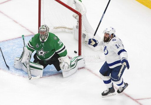 Dallas Stars goaltender Anton Khudobin (35) and Tampa Bay Lightning's Pat Maroon, right, react to a goal by Lightning's Kevin Shattenkirk during overtime of Game 4 of the NHL hockey Stanley Cup Final, Friday, Sept. 25, 2020, in Edmonton, Alberta. (Jason Franson/The Canadian Press via AP)