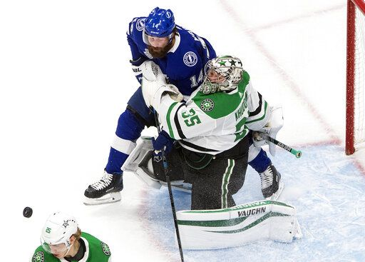 Dallas Stars goalie Anton Khudobin (35) is crashed into by Tampa Bay Lightning's Pat Maroon (14) during second-period NHL Stanley Cup finals hockey action in Edmonton, Alberta, Monday, Sept. 21, 2020. (Jason Franson/The Canadian Press via AP)