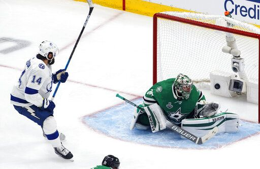 Tampa Bay Lightning's Pat Maroon (14) watches the puck go in past Dallas Stars' goalie Anton Khudobin (35) on a shot from Lightning's Blake Coleman (not shown) during second-period NHL Stanley Cup finals hockey game action in Edmonton, Alberta, Monday, Sept. 28, 2020. (Jason Franson/The Canadian Press via AP)