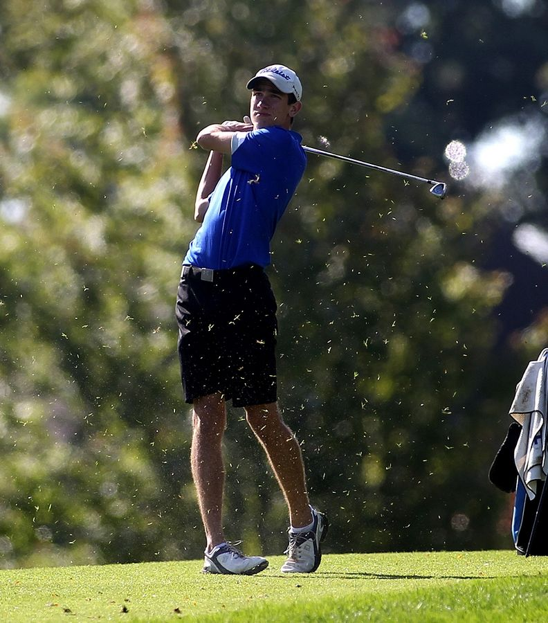 Geneva's Cal McKittrick hits from the 10th fairway during the DuKane Conference Tournament at Bartlett Hills Golf Course on Tuesday.