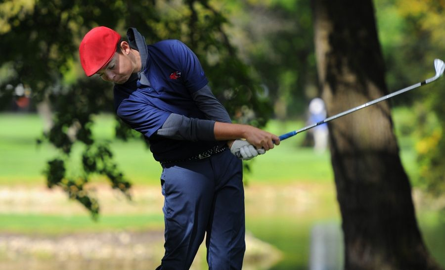 Nicolas Simon of Conant shows perfect form on his follow-through drive on the 14th hole during the MSL boys golf Tournament at Old Orchard Country Club in Mount Prospect.
