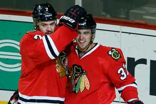 Brent Seabrook, left, congratulates Brandon Pirri after he scored against Toronto Oct. 19, 2013 at the United Center.