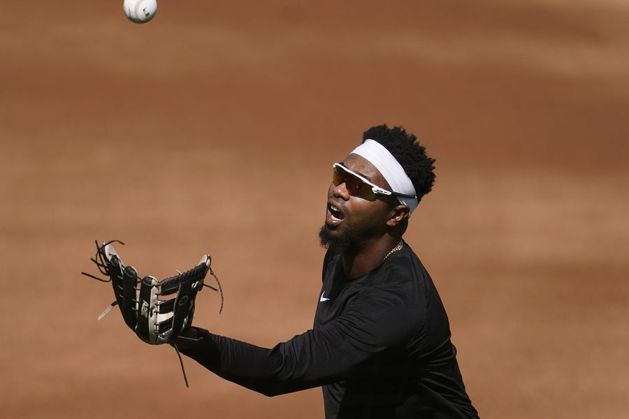 Chicago White Sox's Eloy Jimenez catches a ball during practice Monday in Oakland, California. Jimenez is not in the starting lineup for Game 1 against the A's.
