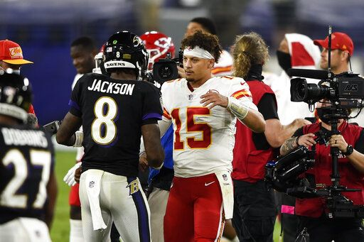 Baltimore Ravens quarterback Lamar Jackson (8) and Kansas City Chiefs quarterback Patrick Mahomes (15) embrace after an NFL football game Monday, Sept. 28, 2020, in Baltimore. The Chiefs won 34-20.