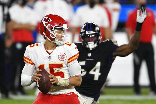 Kansas City Chiefs quarterback Patrick Mahomes (15) looks to pass under pressure from Baltimore Ravens linebacker Tyus Bowser (54) during the second half of an NFL football game, Monday, Sept. 28, 2020, in Baltimore.